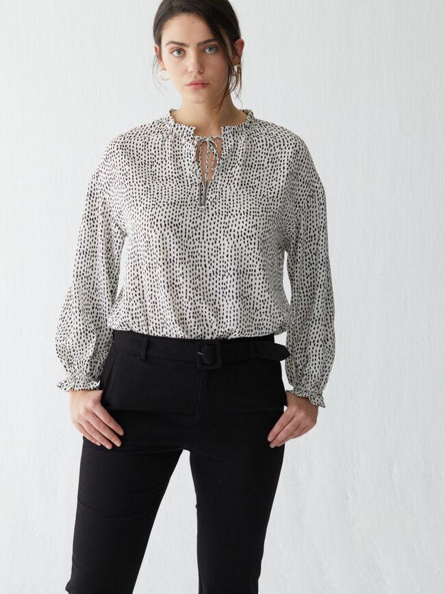 Blusa estampado bicolor lazada Crudo
